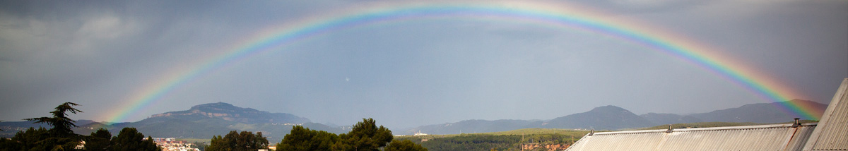 View from building VII Centennial, with a background rainbow